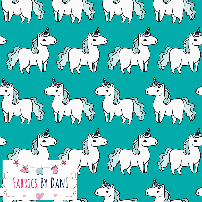 Unicorns on Teal Fabric